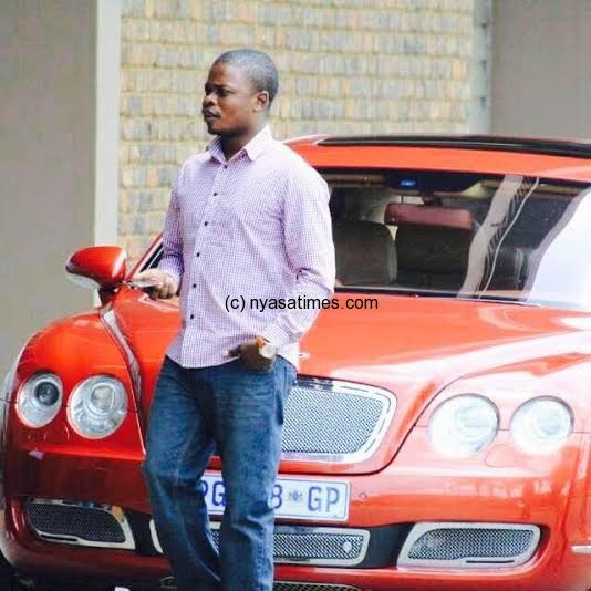 Bushiri standing on his new Bently car:  Have faith