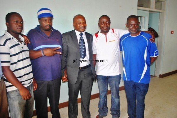FAM CEO Sugzo Nyirenda pose with Wanderers and Bullets top fans....Photo Jeromy Kadewere