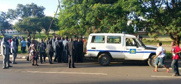 Members of Parliament trying to remove the police vehicle. Police mounted a roadblock before arresting Kabwila