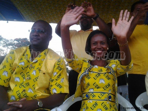 Atupele Muluzi accompanied by his wife Angella, a former lawmaker, holds a modern-day whistle stop rally