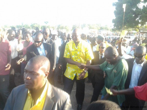 Atupele walking to the podium after arriving at the venue of the rally
