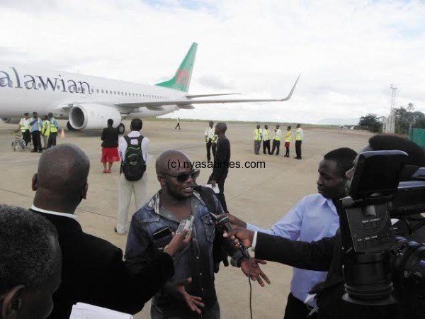 Brastus Msiska speaking to journalists at Chileka Airport after landing from Johannesburg- Pic Lucky Mkandawire