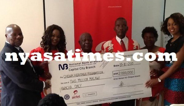 Chefo officials in a symbolic presentation of the dammy cheque from Airtel official Norah Chavula