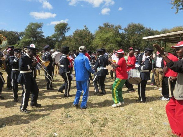 Dancing time- Malawi Police Band is joined by Massa officials.