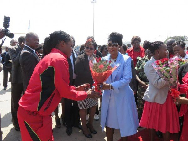 First Lady greets one of the players