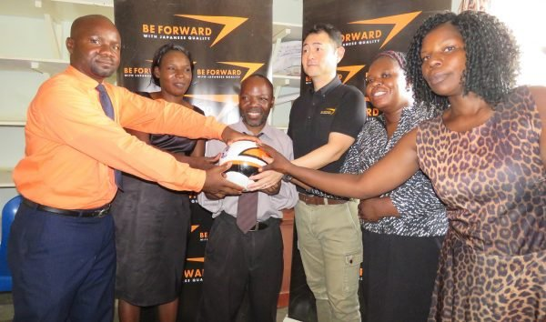 Be Forward Wanderers presenting balls to Mvayani school teachers
