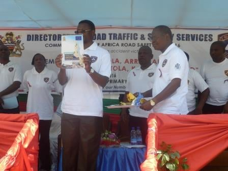 Ndau showing off the book containing information on preventing road accidents. Pic Sellah Singini (MANA)