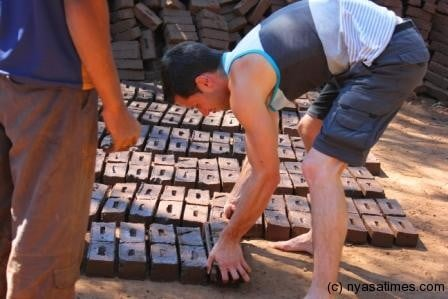 Neil George moulding bricks in Mposa, Machinga