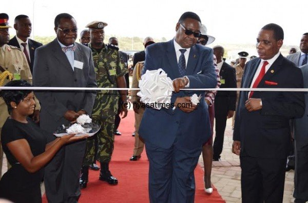 President Mutharika accompanied by Hon ... pping Mall - Pic by Stanley Makut