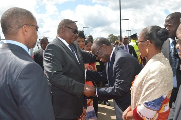 President Peter Mutharika is welcomed by the Reserve Bank Governor Charles Chuka on arrival at Reserve Bank Mzuzu Branch (C)Stanley Makuti