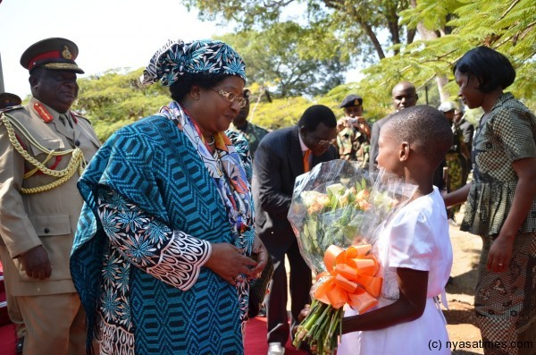 The President meets a Flower Girl at Chilumba Barracks