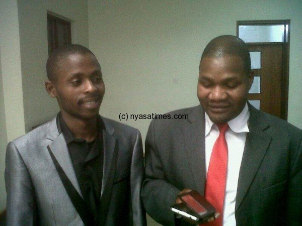 Journalist Mponda (left) with his lawyer Chancy Gondwe
