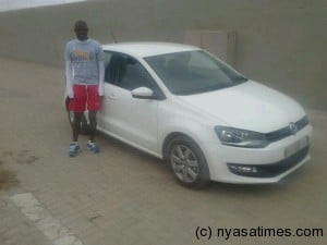 Kanyenda posing with the car given to him